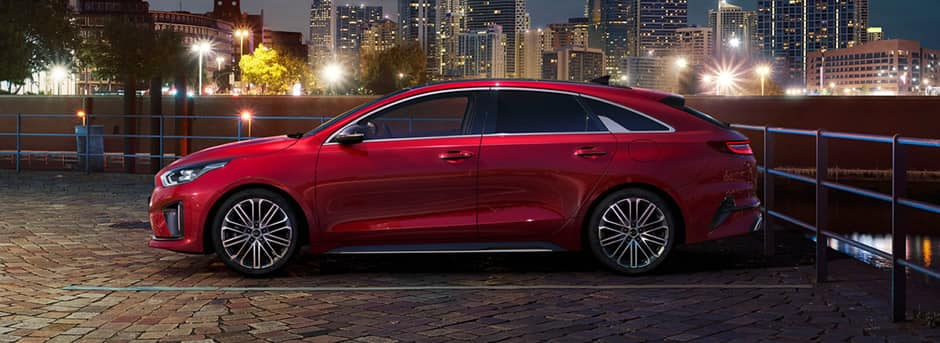 red kia proceed side view